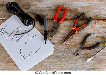 Electrical equipment. Electrical tools and power cables for installation and network connection. Wooden background,