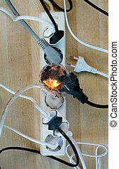 Fire in overloaded power strip. European style connectors.