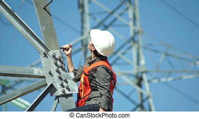 Electrical High Tension Pole Woman