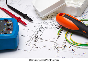 A set of electrical instruments laying on blueprit