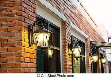 electrical lamp latern on red brick wall