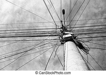 Electrical lines - A street lamp post with many electrical ...