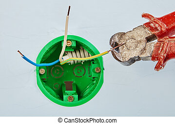 Electrical maintenance with cutting pliers.