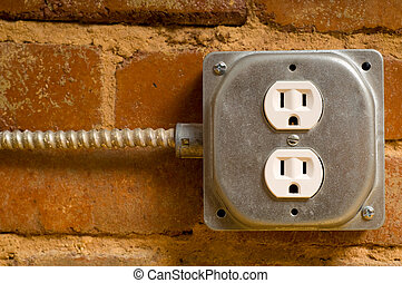 Electrical Outlet - Industrial electrical outlet on a red...