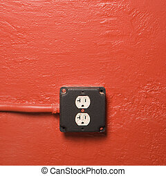Electrical outlet. - Red wall with electrical outlet.