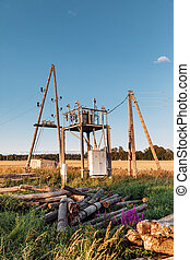 Electrical post by the road