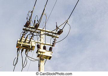 Electrical post with sky background