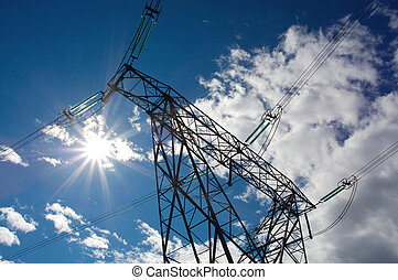 Electricity power pylon with sun and clouds