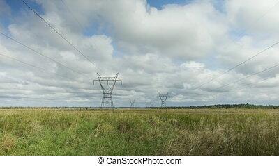 Electrical pylons in field.