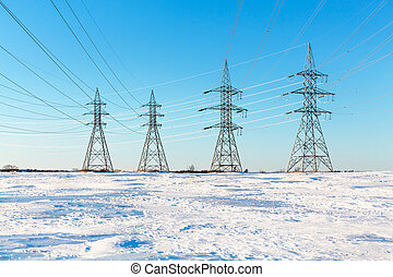 Electrical pylons in the snow. Montreal, Canada.