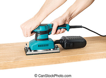 Carpenter working with electrical sander.