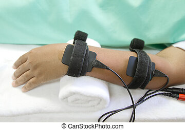 Electrical stimulation forearm ,physical therapist helping woman with eletrical stimulator for increase muscle strenght and release pain