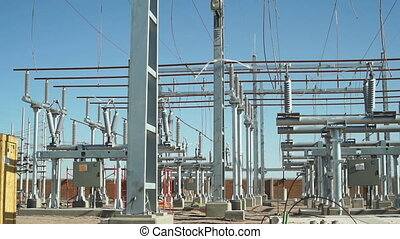 Electrical Substation Construction - Long panning shot of an...