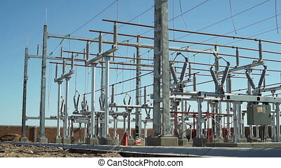 Electrical Substation Construction - Wide panning shot of an...