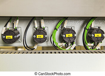 Electrical switches and wires on control panel
