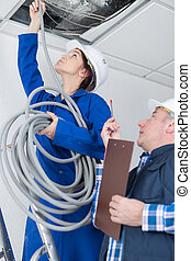 electrical team wiring a room