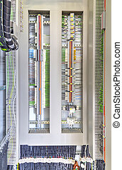 Electrical terminals and wires in industrial control panel