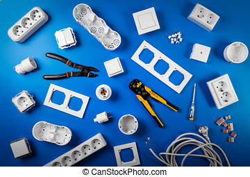 electrical tools and equipment on blue background. top view flat lay