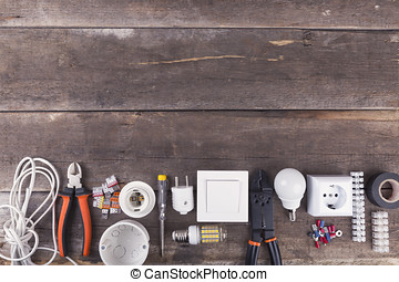 electrical tools and equipment on wooden background with copy space