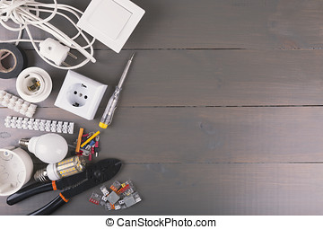 electrical tools and equipment on wooden table with copy space