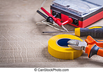 electrical tools composition on wood background