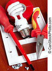 electrical tools, bulbs, tape, light switch
