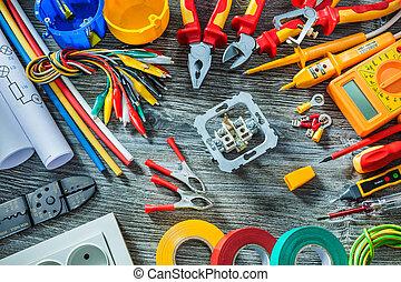 electrical tools set on vintage wood background