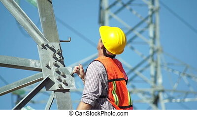 Electrical Tower Man OK Closeup - Closeup shot of a male...