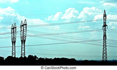 electrical towers and cloudy sky