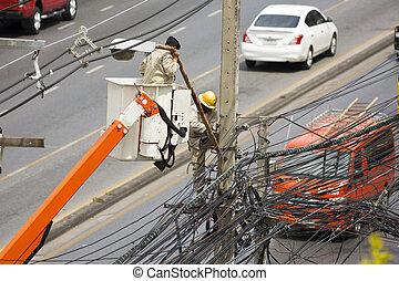 Electrical wireman repair the street light