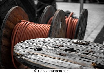 Electrical wires on wooden spool closeup photo