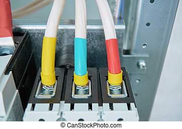 Electrical wires or cables are connected to the circuit breaker.