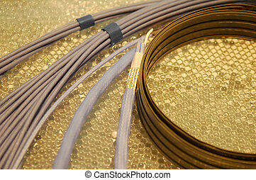 electrical wires - assorted electrical wiring on a golden...