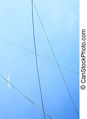 Electrical wires  on the background of blue sky