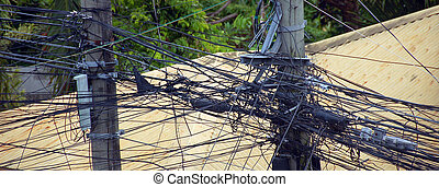 Electrical wires very entangled between electric poles, Asia