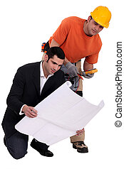 Electrician and architect looking at plans
