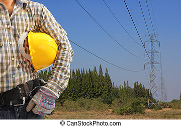 Electrician and  high voltage tower blue sky background