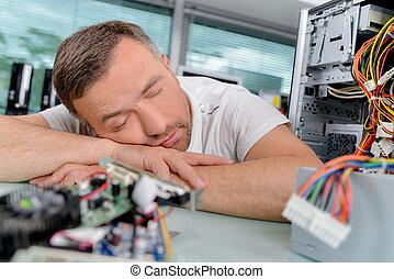 Electrician asleep on the job