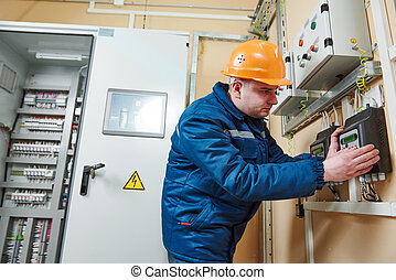 Electrician at work - electrician installing or check...