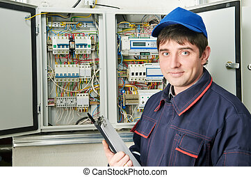 Electrician at work - One electrician working on a ...