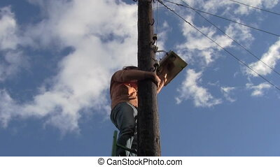 electrician - changing light bulb on a street lamp