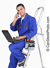 Electrician chatting to customer on the phone
