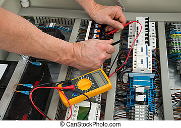 Electrician Checking A Fuse Box
