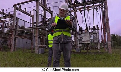 Electrician checking documentation