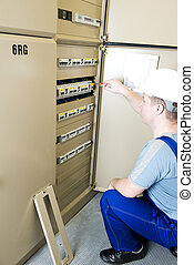 electrician checking electrical power distribution board