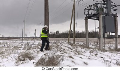 Electrician checking  power lines