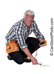 Electrician checking the voltage and getting a shock