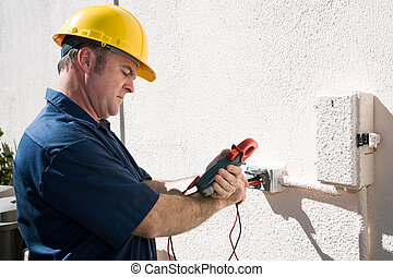 Electrician Checking Voltage - Electrician using a meter to...
