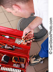 Electrician choosing a tool
