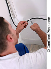 Electrician clipping a wire